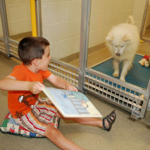 Dogs Help Children Read - Children reading to dogs at the Missouri Humane Society's Shelter Buddies Reading Program.