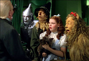 The Wizard of Oz and Political Symbolism: Dorothy, Tin Woodman, Scarecrow, Lion, and the Wizard.